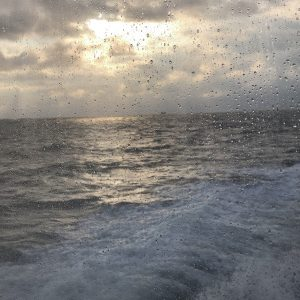 view of water, sun and clouds